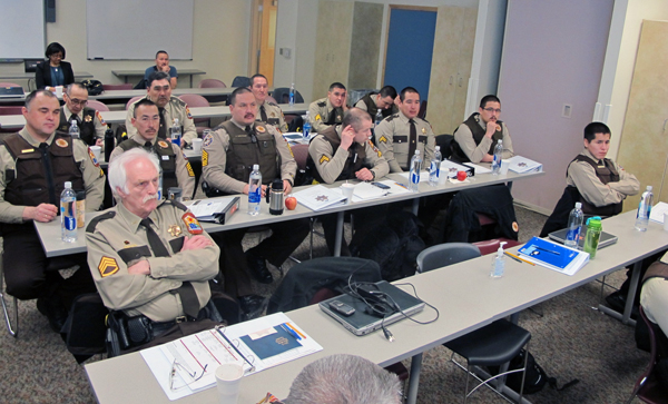 YK Delta VPSOs spoke with DPS officials about the process of arming VPSOs during training in Bethel. (Photo by Ben Matheson / KYUK)
