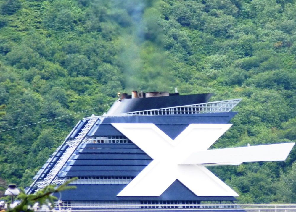 A Celebrity Cruise Line ship sails into Juneau in 2012 with emissions coming out of its stack. New pollution-control equipment being installed on Alaska-bound and other ships will reduce the emissions plume. (Ed Schoenfeld, CoastAlaska News-Juneau)