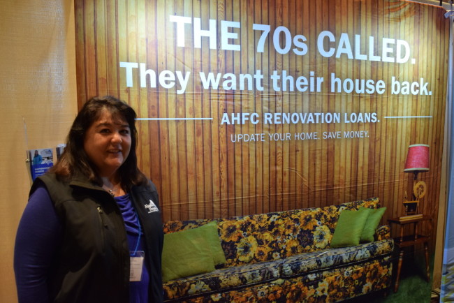 Jan Miyagishima at the AHFC booth at the Juneau Home and Outdoor Living Expo. (Photo By Casey Kelly. KTOO-Juneau)