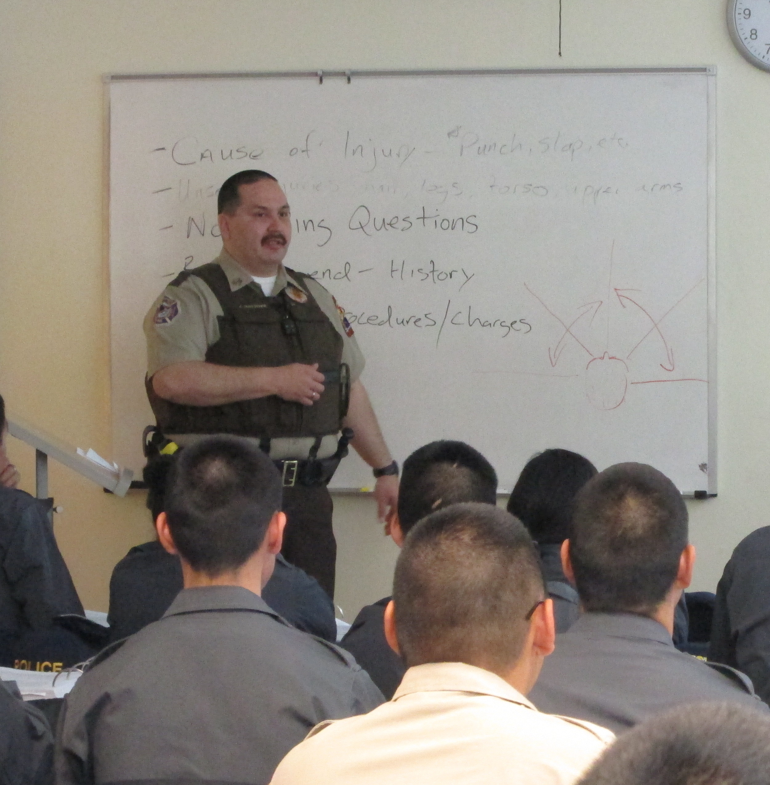 First Sergeant James Hoelscher instructs officers at a 2014 training. Photo by Ben Matheson / KYUK.