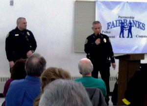 Fairbanks Police Officer Richard Sweet, left, and Chief Randall Aragon explain community policing at Tuesday night's meeting at the J.P. Jones Community Center in South Fairbanks. (Credit Tim Ellis/KUAC)