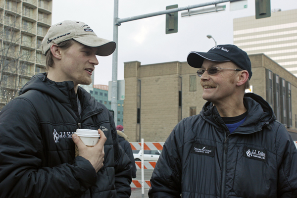 Dallas and Mitch Seavey talk before the ceremonial start of the 2015 Iditarod. (Photo by Josh Edge, APRN - Anchorage)