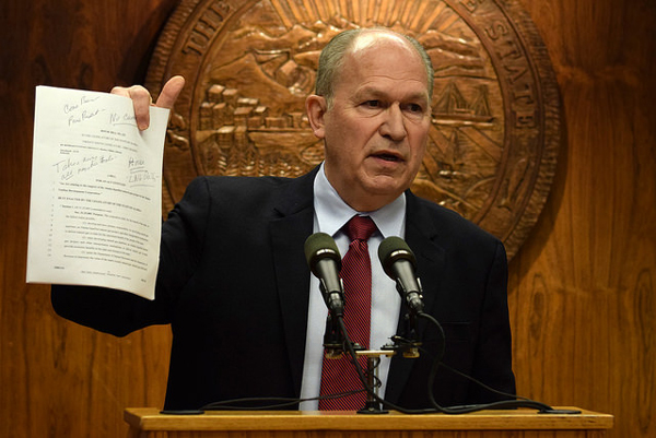 In a press conference March 2, 2015, Gov. Bill Walker holds up a copy of House Bill 132 that would limit the Alaska Gasline Development Corporation's powers on the Alaska Stand Alone Pipeline. House leaders introduced it earlier that day. The governor was adamant that the bill would hinder rather than help progress for the project by tying the state's hands during negotiations. (Photo by Skip Gray/360 North)