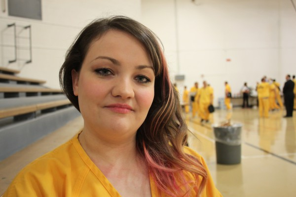 Catherine Fredrick at a prison event in the Lemon Creek Correctional Center gymnasium. Fredrick lives in the tent. (Photo by Lisa Phu/KTOO)