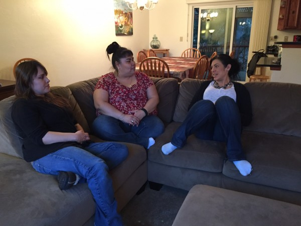 Haven House's first resident, Delia Williams (left), sits with Haven House staff Jennifer Brown and Kara Nelson. (Photo by Lisa Phu/KTOO)