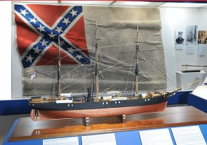Model of Shenandoah, in front of her Confederate flag, the last lowered in surrender.