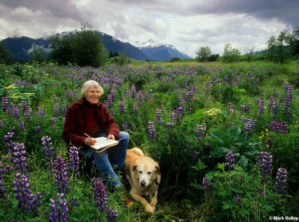 Rie Muñoz with her dog Muncie in the Mendenhall Wetlands, Juneau in 2008. (Photo by Mark Kelley)