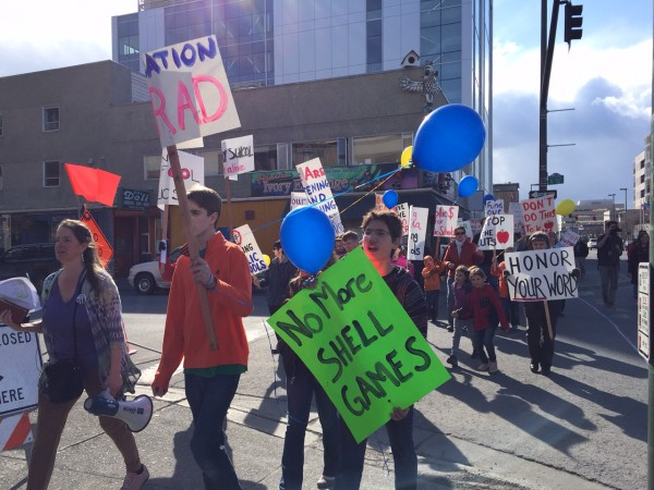 Community members walk through downtown Anchorage to protest education funding cuts. Hillman/KSKA