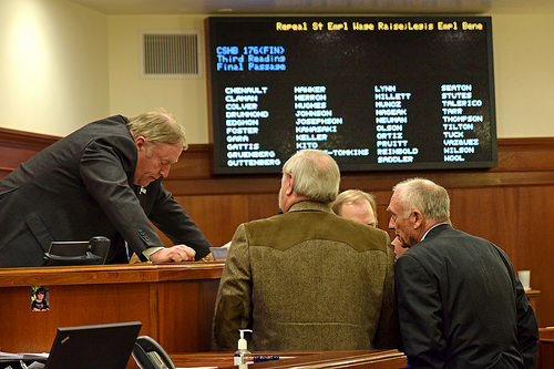 House Speaker Mike Chenault, R-Nikiski (left) confers with other members of the House leadership just before the vote on House Bill 176, April 15, 2015. The bill repeals a 2.5 percent pay raise for state employees scheduled to take effect July 1, 2015. (Photo by Skip Gray/360 North)