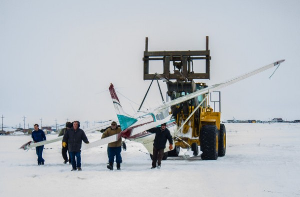 A team of responders transporting the damaged Cessna 185 after it landed at Nome's City Field on Thursday afternoon. (Photo: Francesca Fenzi)
