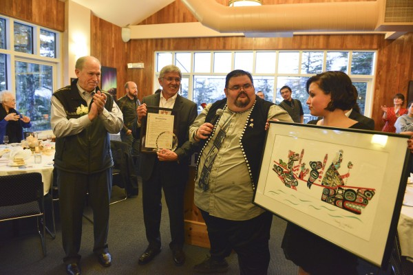 Gov. Bill Walker, Lt. Gov. Byron Mallott, and Tlngit Haida Central Council President Richard Peterson at council assembly April 17.  Mallott received a lifetime achievement award. (Creative Commons photo courtesy Alaska Governor's Office)