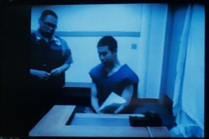 A guard appeared with 24-year-old Justine Paul by video from the Yukon Kuskokwim Correctional Center for arraignment on First Degree Murder charges. – Photo by Daysha Eaton/KYUK