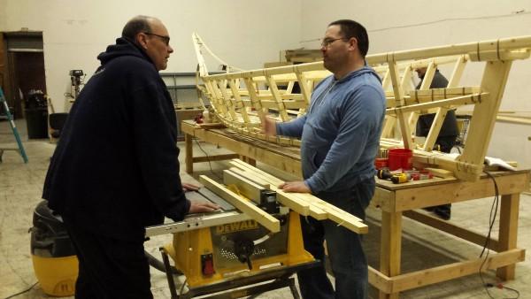 CJ Christiansen (right) and Mitch Keplinger discuss what to do next on boat. (Photo by Kayla Desroches, KMXT – Kodiak)