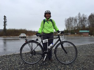 Anne at the halfway point. Photo courtesy of another biker who was willing to knell in the rain with her iPhone.