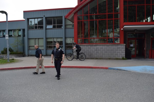 Juneau Police officers made sure Juneau-Douglas High School was secure after a threatening call prompted heightened security at the school for the second time in eight days. (Photo by Casey Kelly/KTOO)