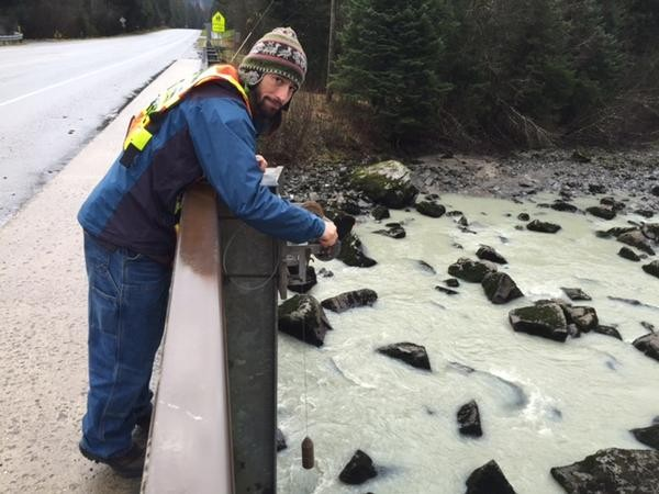 Hydrologist Aaron Jacobs takes the final Mendenhall River reading of 2014 in November. (Photo courtesy National Weather Service)