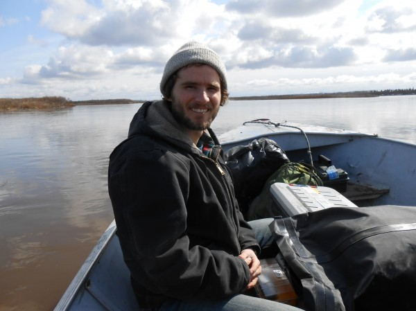 Sean Brennan doing research on the Nushagak River. Credit UAF