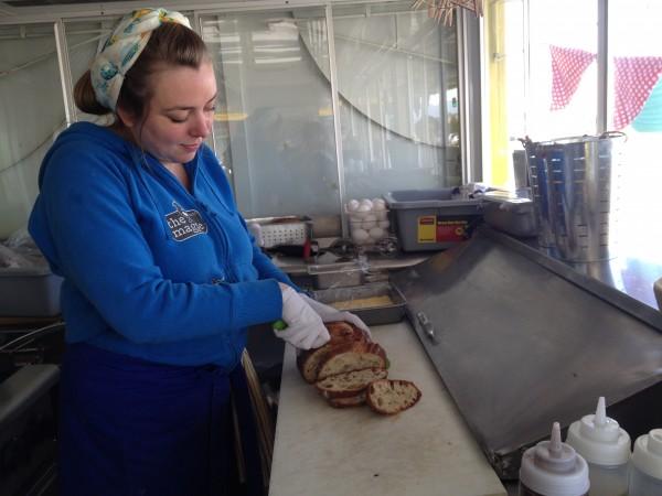Amanda Cash slices rosemary bread for an egg sandwich.
