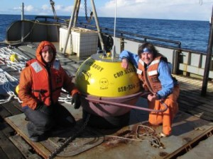 Angie Doroff of the Kachemak Bay Research Reserve and Kris Holderied of NOAA's Kasitsna Bay Laboratory with Bandit the Buoy