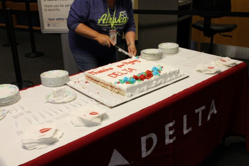 Delta doled out slices of strawberry-filled cake to passengers. The cake was made at AC Lakeside. (Emily Kwong/KCAW)