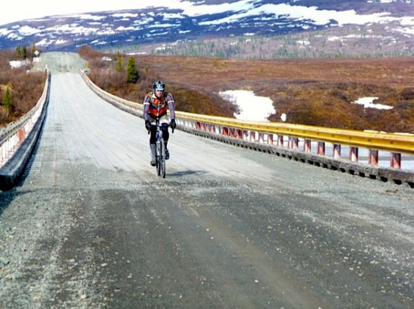 A biker chugs along the Denali Highway. Photo: Alaska Endurance Association.
