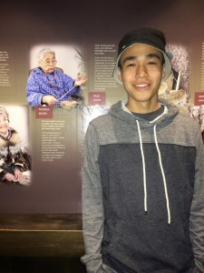 Byron Nicholai in the American Indian Museum in front a a picture of his grandmother. -Photo courtesy of Bryon Nicholai.