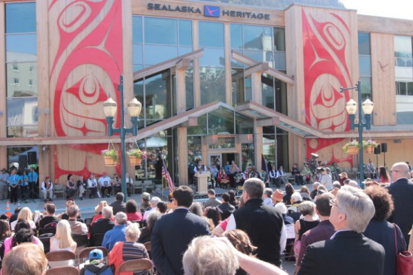 A large crowd gathered in front of the Soboleff Building listen to a series of speakers (Photo by David Purdy/KTOO)