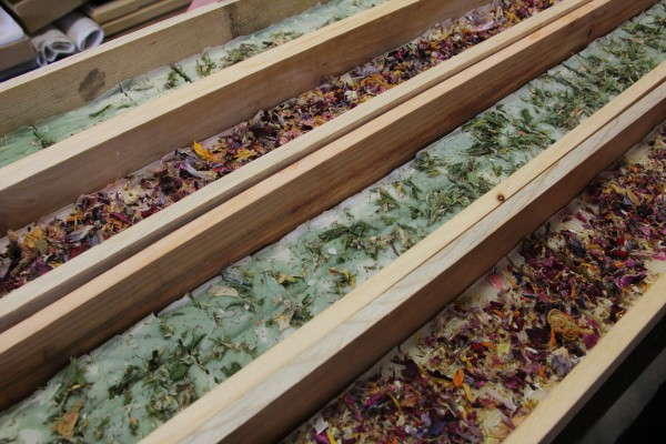 The bars of soap are carefully crafted and topped with dried flower petals. (Photo by Hannah Colton, KDLG – Dillingham)