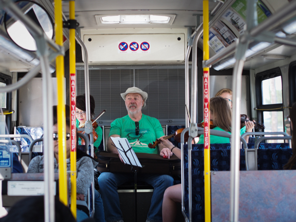 A group of chamber musicians played for nearly an hour as the 45 bus wound through town, part of a city-wide cultural event drawing crowds to a central location. (Photo: Zachariah Hughes, KSKA)