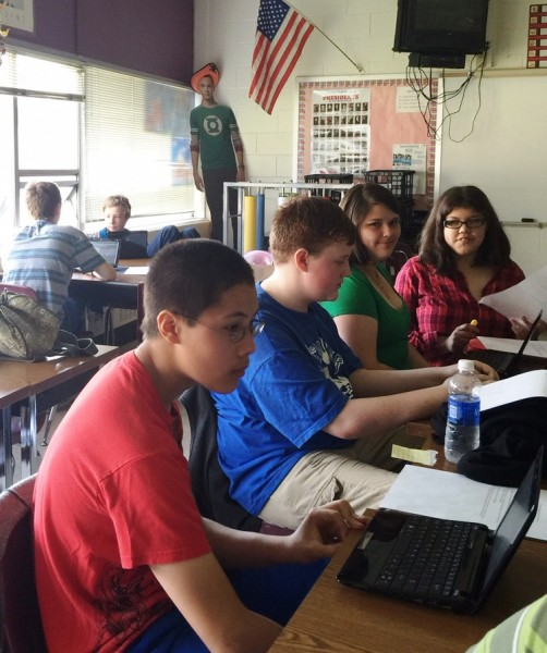 Students working on presentations at Central Middle School. From left: Edward Hazelton, Draven Maynard, Alissa Steinbich, and Kayleigh Godbee. Photo courtesy of Aura Beatty.