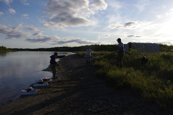 Matt Nemeth, Dirk Middleton and Chris Sewright get sonar pods ready to deploy in the Kvichak River near Igiugig on May 29, 2015. The pods are part of a smolt abundance study on that river conducted by the Bristol Bay Science and Research Institute and the Alaska Department of Fish and Game. Credit Molly Dischner/KDLG