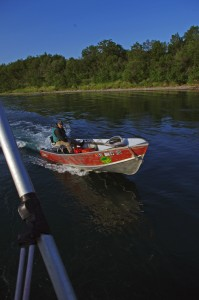 Blueberry Island Lodge owner George Riddles brings his skiff alongside the F/V Eagle Claw June 17, 2015, before hopping on board to help gillnetters navigate the Kvichak River braids.