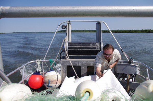 Jonathan Flora makes a hammock from net bags onboard the F/V Eagle Claw June 17, 2015.