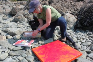 As the tide comes in, Baltuck gathers her art supplies. (Photo by Lisa Phu/KTOO)