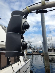 """The EM cameras on the Magia, Steven Rhoads' 55-foot longliner, are mounted on an outrigger boom. """"I would pay to have electronic monitoring every day, rather than be selected to carry a human observer,"""" Rhoads told the council. (KCAW photo/Robert Woolsey)"""