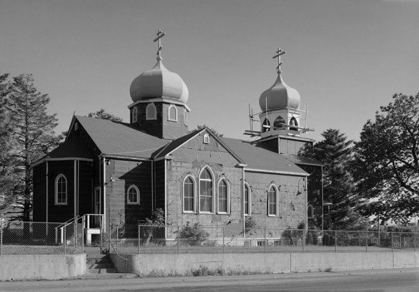 Northeastern side of the Holy Resurrection Church, a Russian Orthodox church in Kodiak, a city in the Kodiak Island Borough of the U.S. state of Alaska. Built in 1945, the church was added to the National Register of Historic Places on 12 December 1977.  Photo by NPS.