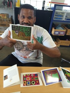Andre Hogg shows off note cards with his  paintings. Photo courtesy of Sparc!