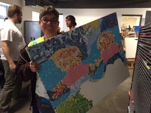 Debra Burt shows off her latest collage. Hillman/KSKA