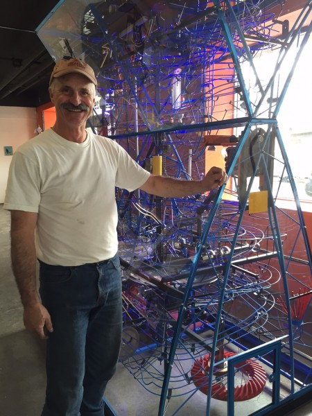 "John Will and his sculpture, ""One Man's Trash..."" Hillman/KSKA"