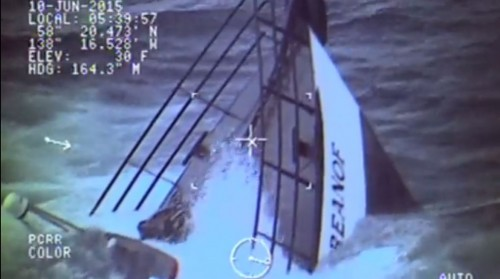 The 80-foot tender Kupreanof slips beneath the waves just seconds after the last crew member was hoisted aboard an Air Station Sitka helicopter. (USCG image)