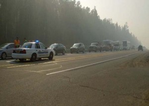 Troopers stop traffic on the Parks Highway Monday morning as the Sockeye Fire spreads. (Photo by John Norris - Alaska Public Media)