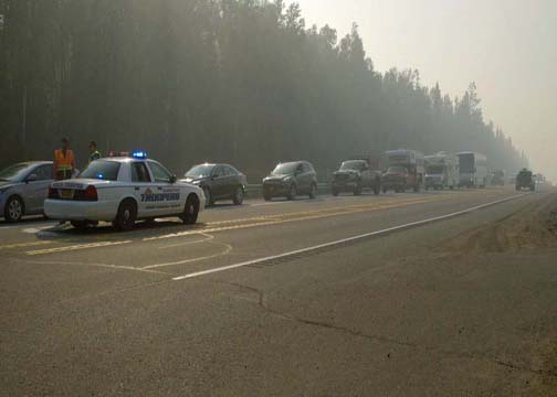 Troopers stop traffic on the Parks Highway Monday morning as part of traffic control along the Parks Highway. (Photo by John Norris - Alaska Public Media)