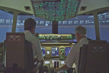 Pilots flying simulator (L to R) Less Abend and Mark Weiss. (Photo Courtesy of WGBH)
