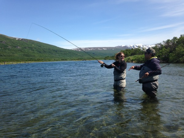 David Parks Jr. gives some casting tips to his client Sarah Pearl in the Kulik River. Credit Matt Martin/KDLG