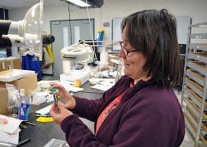 Anne Jensen examines artifacts in her lab. (CREDIT ANNE JENSEN)