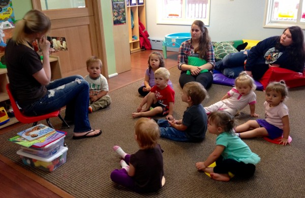 Teacher Theressa Phillips reads to the toddler class with Assistant teacher, Brina Compton and teen worker, Kallie Caples looking on. Photo/Angela Denning