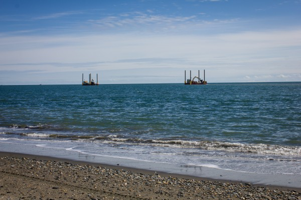 Two dredges mine off the coast of Nome's West Beach in June 2015. Photo: Francesca Fenzi