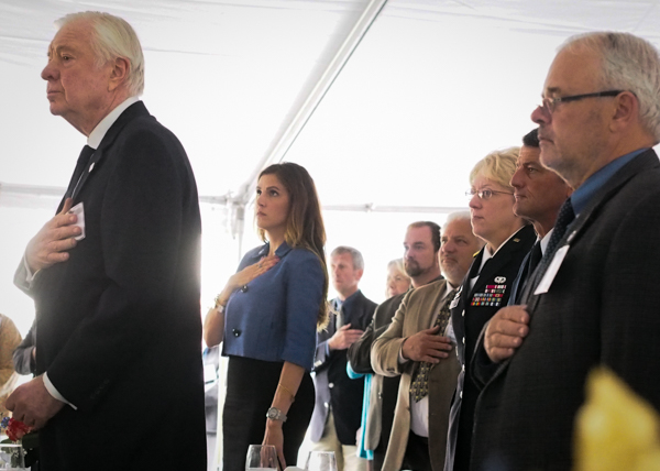 From right to left, House member Bob Herron, Lt. Gen. Russell Handy, Adjudant General Laurie Hummel, Taya Kyle in Blue, and Allen Miller, CEO of UHS. (Photo: Zachariah Hughes, KSKA)