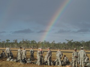 Members of the 4-25th Airborne Brigade congregate under a rainbow during exercise Talisman Saber. Photo: Zachariah Hughes/KSKA.