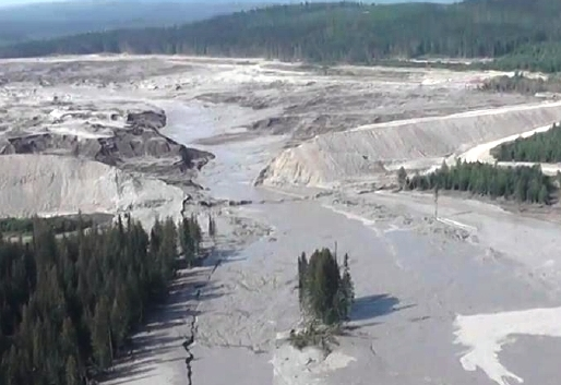 This aerial image shows the Aug. 5, 2014, Mount Polley Mine tailings dam break and some of the damage downstream. The mine just won permission to reopen on a limited basis. (Photo courtesy Cariboo Regional District Emergency Operations Centre)